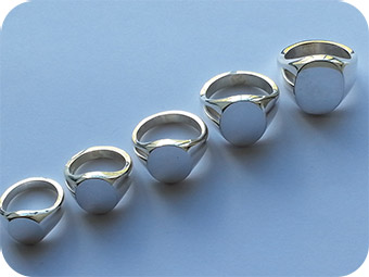 Hallmarked sterling silver signet rings in various sizes